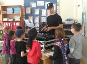 Akiva Grade 2 Students learn some music moves from DJ Yo-C